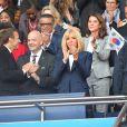 Le président de la République Emmanuel Macron et la première dame Brigitte Macron - People dans les tribunes du parc des Princes pour l'ouverture de la coupe du monde féminine de football 2019 (Mondial), opposant la France à la Corée du Sud. Paris le 7 juin 2019 © Pierre Perusseau / Bestimage