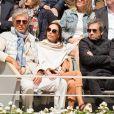 Dominique Desseigne et Alexandra Cardinale assistent à la demi-finale simple messieurs Djokovic - Thiem lors des internationaux de France de tennis de Roland Garros à Paris, France, le 8 juin 2019.