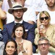 Sienna Miller dans les tribunes du tournoi de Wimbledon 2019 à Londres, le 8 juillet 2019.