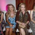 "Tanja Bülter, Christine Neubauer, Catherine Deneuve, Nina Bott lors du défilé de mode ""Ernsting's family Fashion Show"" à Hambourg. Le 11 juillet 2019"