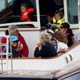 Carole et Michael Middleton, le prince George de Cambridge, la princesse Charlotte - Les enfants du duc et de la duchesse de Cambridge regardent d'un bateau la régate King's Cup le 8 août 2019.