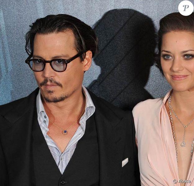 Johnny Depp et Marion Cotillard, au Gaumont Marignan, à l'occasion de l'avant-première de Public