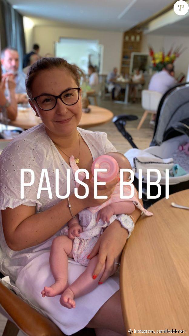 Camille Delcroix, sa compagne et leur fille Rose au restaurant- Sept 2019.