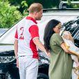 Le prince Harry, duc de Sussex, Meghan Markle, duchesse de Sussex et leur fils Archie Harrison Mountbatten-Windsor lors d'un match de polo de bienfaisance King Power Royal Charity Polo Day à Wokinghan, comté de Berkshire, Royaume Uni, le 10 juillet 2019.