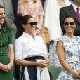 """Catherine (Kate) Middleton, duchesse de Cambridge, Meghan Markle, duchesse de Sussex, et Pippa Middleton dans les tribunes lors de la finale femme de Wimbledon """"Serena Williams - Simona Halep (2/6 - 2/6) à Londres, le 13 juillet 2019."""