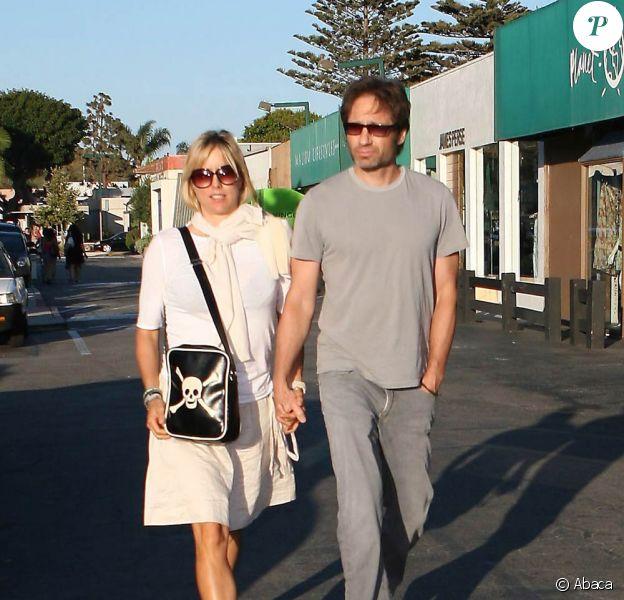 David Duchovny et sa femme Téa Léoni, main dans la main à Los Angeles (12 juillet 2009)