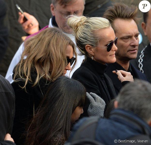 Laeticia Hallyday, ses filles Joy et Jade, Laura Smet, David Hallyday - Sorties de l'église de la Madeleine après les obsèques de Johnny Hallyday à Paris le 9 décembre 2017. © Veeren / Bestimage