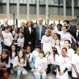 """Guy Alba, le président de l'association ELA, Léonie, âgée de 14 ans accompagnée de ses parents (Francis et Stéphanie), Brigitte Macron, Jean-Michel Blanquer, ministre de l'éducation nationale, Mounir Mahjoubi, député lors de la dictée d'ELA - Dictée d'ELA lors de sa 16e édition au Collège Suzanne Lacore, à Paris, le 14 octobre 2019. Cette dictée est le lancement officiel de la campagne """"Mets Tes Baskets et bats la maladie"""" à l'école. ©Dominique Jacovides/Bestimage"""