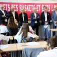 """Léonie, âgée de 14 ans accompagnée de ses parents (Francis et Stéphanie), Guy Alba, le président de l'association ELA, Nicolas Mathieu (Goncourt 2018), auteur de la dictée d'ELA, Jean-Michel Blanquer, ministre de l'éducation nationale, Brigitte Macron - Dictée d'ELA lors de sa 16e édition au Collège Suzanne Lacore, à Paris, le 14 octobre 2019. Cette dictée est le lancement officiel de la campagne """"Mets Tes Baskets et bats la maladie"""" à l'école. ©Dominique Jacovides/Bestimage"""