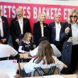 """Léonie, âgée de 14 ans accompagnée de ses parents (Francis et Stéphanie), Guy Alba, le président de l'association ELA, Nicolas Mathieu (Goncourt 2018), auteur de la dictée d'ELA, Brigitte Macron - Dictée d'ELA lors de sa 16e édition au Collège Suzanne Lacore, à Paris, le 14 octobre 2019. Cette dictée est le lancement officiel de la campagne """"Mets Tes Baskets et bats la maladie"""" à l'école. ©Dominique Jacovides/Bestimage"""