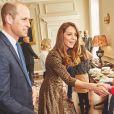 Kate Middleton et le prince William lors d'un événement organisé avec la BBC Radio au palais de Buckingham, en octobre 2019.