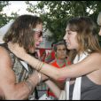 Laura Smet et Mickey Rourke au concert de Johnny Hallyday, le 14 juillet 2009.