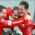 Jean Todt, Rubens Barrichello et Michael Schumacher le 11 octobre 2003.