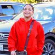 Exclusif - Christina Milian enceinte porte un jogging rouge et un sac Gucci à son arrivée à son Beignet Box truck dans le quartier de Studio City à Los Angeles, le 15 décembre 2019.