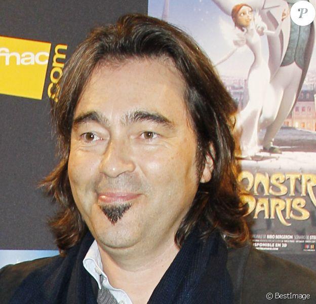 """François Cluzet et Eric Bergeron à l'avant-première du film """"Un monstre à Paris"""", au cinéma Le Trianon, le 8 octobre 2011."""