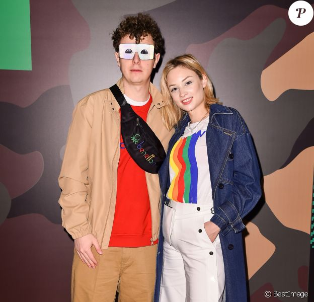 "Norman Thavaud et sa compagne Martha Gambet assistent à la présentation de la nouvelle collection Automne-Hiver 2020-2021 de ""United Colors of Benetton"" lors de la Fashion Week de Milan. Le 20 février 2020."
