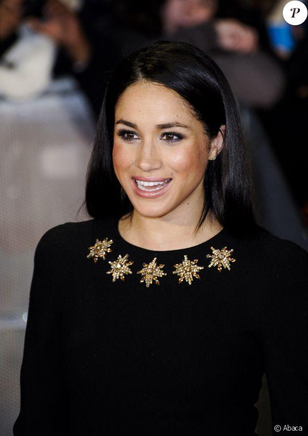 De passage à Londres pour la premiere de 'The Hunger Games: Catching Fire' en 2013, Meghan Markle avait misé sur des faux-cils, un fard irisé et un teint naturel.