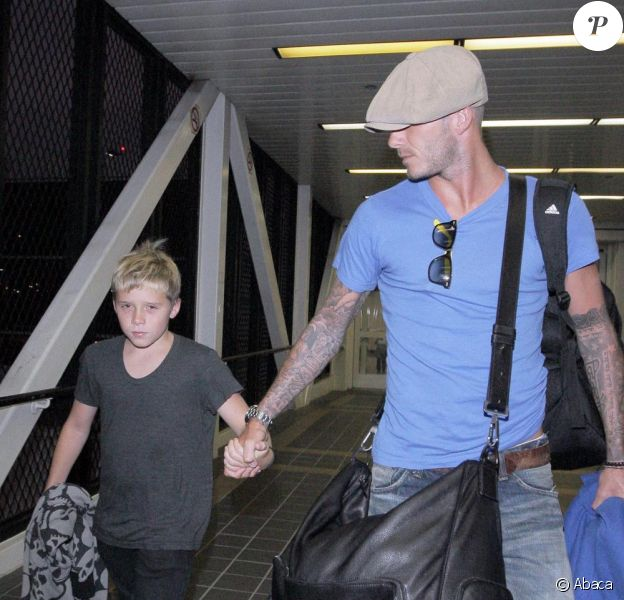 David Beckham et Brooklyn à l'aéroport de Los Angeles le 13/08/09