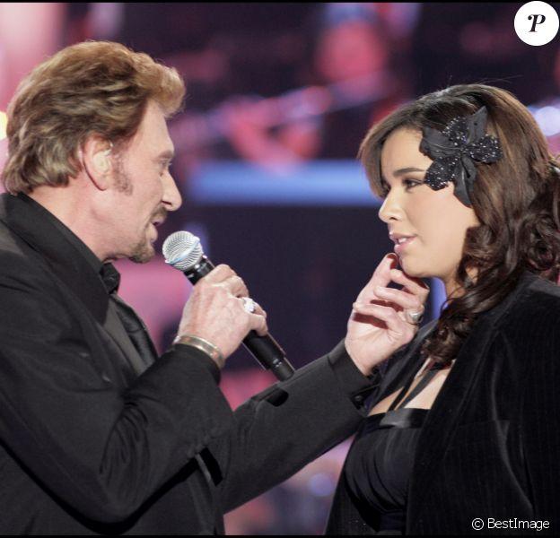 Johnny Hallyday et Chimène Badi, le 1er février 2006 à Paris.