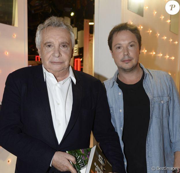 """Michel Sardou et Davy Sardou - Enregistrement de l'émission """" Vivement Dimanche """" Spéciale Les enfants du Top 50, le 8 octobre 2014."""