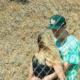 Exclusif - Ashley Benson embrasse son compagnon G-Eazy en marge du tournage d'un nouveau clip du rappeur à Malibu, le 3 septembre 2020.