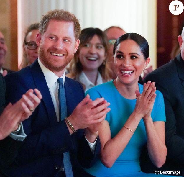 Le prince Harry, duc de Sussex, et Meghan Markle, duchesse de Sussex lors de la cérémonie des Endeavour Fund Awards au Mansion House à Londres, Royaume Uni (2020).