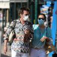 Exclusif - Jean-Michel Jarre et sa compagne Gong Li portent des masques de protection contre le Coronavirus (Covid-19) dans les rues de Saint-Tropez, le 20 juillet 2020.