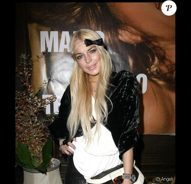 Lindsay Lohan au Café Carmen, le 5 octobre 2009, à l'occasion de la sortie du livre de photographies de Mario Testino.