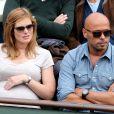 Eric Judor et sa nouvelle compagne enceinte aux Internationaux de France de tennis de Roland Garros à Paris, le 29 mai 2014.