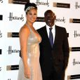 Kimora Lee Simmons et Djimon Hounsou à la soirée Emerald Ball au magasin Harrod's de Londres le 5/11/09