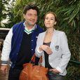 Vanessa Demouy et Philippe Lellouche lors du tournoi de tennis de Roland Garros 2010 à Paris le 27 mai 2010