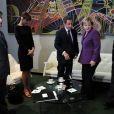 Bernard Kouchner, Carla Bruni, Nicolas Sarkozy, Angela Merkel et Louis Sarkozy lors d'une rencontre privée au quartier général de l'ONU à New York avec la chancelière allemande le 20 septembre 2010
