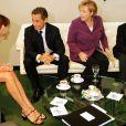 Carla Bruni, Nicolas Sarkozy, Angela Merkel et Louis Sarkozy lors d'une rencontre privée au quartier général de l'ONU à New York avec la chancelière allemande le 20 septembre 2010