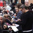 Robbie Williams et Take That quittent les studios de Radio 1 à Londres, le 27 octobre 2010