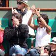 Sonia Rolland et Jalil Lespert amoureux et concentrés au tournoi de Roland-Garros, le 31 mai 2011.