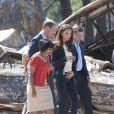 Sacrifiant leur parenthèse amoureuse, le prince William et Kate Middleton se sont rendus mercredi 6 juillet 2011 à Slave Lake, un village du nord de la province de l'Alberta dévasté par un terrible incendie le 15 mai.