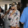 Fergie fait un défilé de mode à l'aéroport de LAX, Los Angeles le 25 août 2011