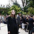 Lors de sa dernière sortie en public, Carla Bruni-Sarkozy affichait clairement un ventre très arrondi dans une robe noire. Paris, 23 septembre 2011