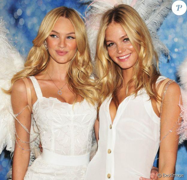 Candice Swanepoel et Erin Heatherton lors du lancement du nouveau parfum et du nouveau soutien-gorge de la maison Victoria's Secret à New York.