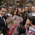 Carla et Nicolas Sarkozy ont passé une douce journée avec les enfants pour le Noël de l'Elysée ce mercredi 14 décembre 2011