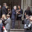 Padma Lakshmi, soutenue par Michael Rubens Bloomberg, aux obsèques de son ami Ted, décédé d'un cancer. Le 29 novembre 2011, à New York
