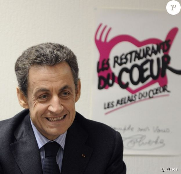 Nicolas Sarkozy en visite dans un centre des Restos du coeur parisien le 22 décembre 2011