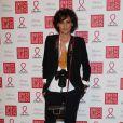Inès de la Fressange, photographe stylée et décontractée lors du dixième Dîner De La Mode contre le Sida à Paris, le 26 janvier 2012.