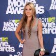 Amanda Bynes en juin 2011 lors des MTV Movie Awards, un an précisément après avoir annoncé l'arrêt de sa carrière d'actrice. Le 6 avril 2012, elle a été arrêtée ivre au volant de sa BMW dans West Hollywood après avoir heurté un véhicule de police.