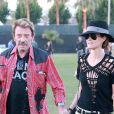 Johnny Hallyday et sa belle Laeticia au festival de Coachella le 14 avril 2012.