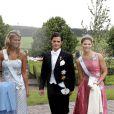 Madeleine, Carl Philip (filleul du prince Leopold de Bavière) et Victoria de Suède au mariage du prince Manuel de Bavière et de la princesse Anna de Sayn-Wittgenstein-Berleburg, le 6 août 2005 en Suède.