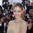 Barbara Palvin, ravissante dans sa robe Valentino, foule le tapis rouge du Palais des Festivals pour la projection du film Lawless. Cannes, le 19 mai 2012.
