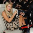 Paris Hilton a profité avec son ami Jean-Roch de la soirée de The Heart Fund au Nikki Beach samedi 19 mai 2012, en marge du Festival de Cannes.
