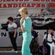 Le prince Albert et Charlene le 26 mai 2012 dans le paddock à la rencontre de personnes hadicapées à l'occasion du Grand Prix de Monaco