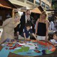 Albert et Charlene de Monaco découvrent le salon Monacology qui se tient du 12 au 15 juin sur la Quai Antoine 1er de la principauté, le 12 juin 2012.